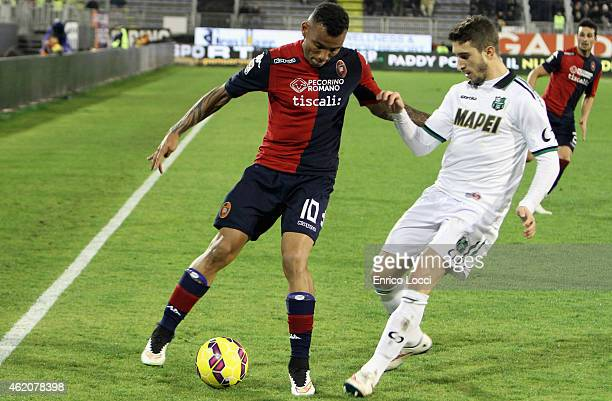 contrast with Joao Pedro of Cagliari and a player of Sassuolo during the Serie A match between Cagliari Calcio and US Sassuolo Calcio at Stadio...