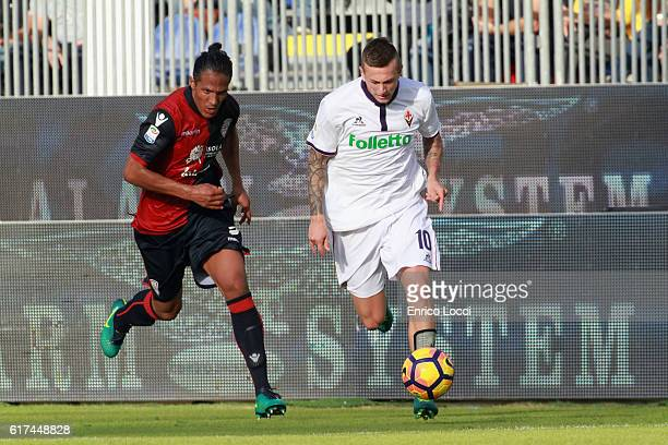 contrast with Kalinic Nikola of Fiorentina and Bruno ALves of Cagliari during the Serie A match between Cagliari Calcio and ACF Fiorentina at Stadio...