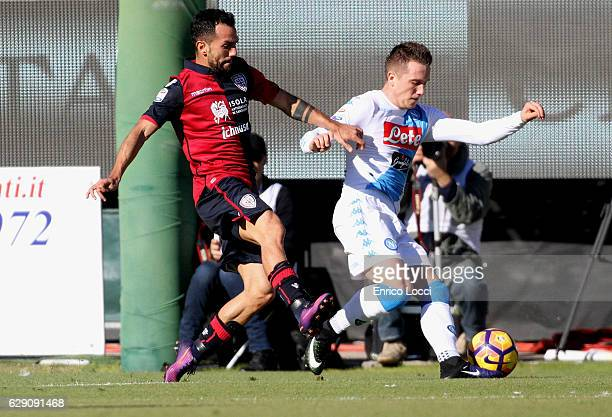 Contrast with Marco Sau of Cagliari during the Serie A match between Cagliari Calcio and SSC Napoli at Stadio Sant'Elia on December 11 2016 in...