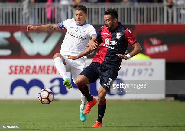 Contrast with Mauricio Isla of CAgliari and a player of Atalanta during the Serie A match between Cagliari Calcio and Atalanta BC at Stadio Sant'Elia...