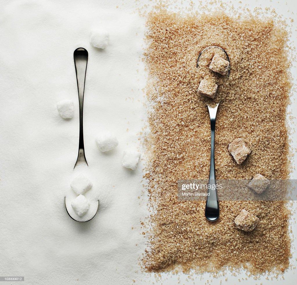 Contrasting sugar, turbinado sugar and sugar cubes with spoons