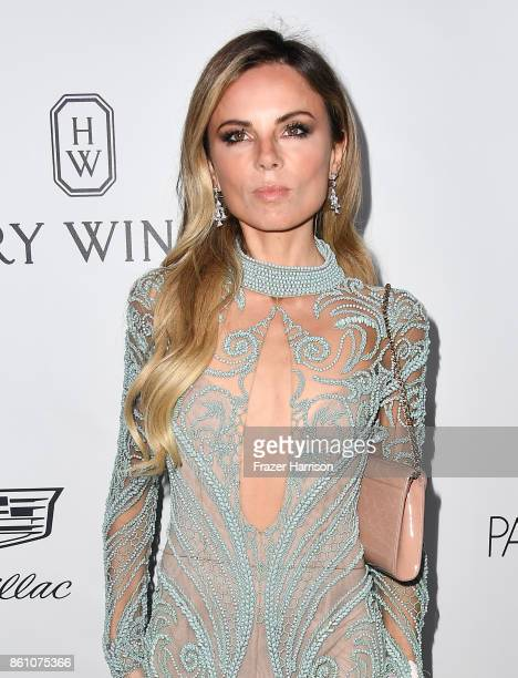 Contributing fashion editor Erica Pelosini attends the amfAR Gala at Ron Burkle's Green Acres Estate on October 13 2017 in Beverly Hills California