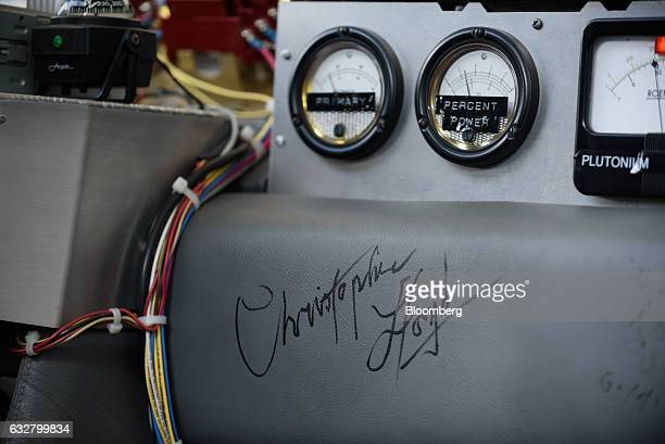 Control dials and the signature of actor Christopher Lloyd are seen inside a replica of the timetraveling DeLorean featured in the film 'Back to the...