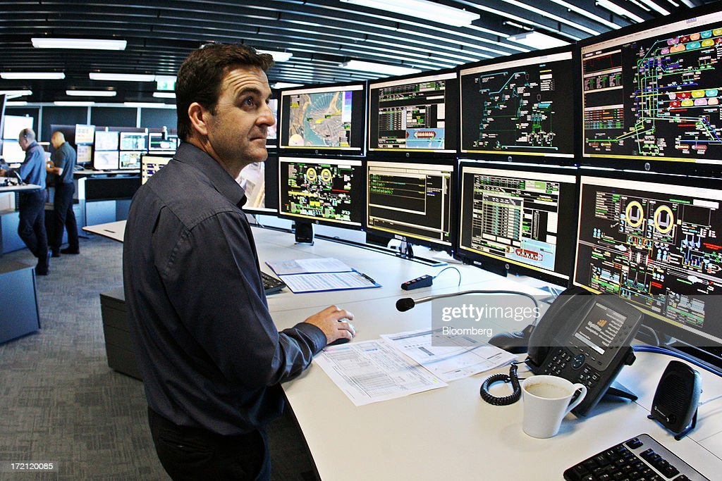 A control officer monitors the flow of iron ore from pit-to-port at BHP Billiton Ltd.'s new Integrated Remote Operations Center in Perth, Australia, on Tuesday, July 2, 2013. BHP Billiton is the world's largest mining company. Photographer: Sergio Dionisio/Bloomberg via Getty Images