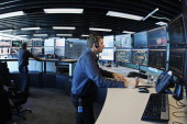 Control officers monitor the flow of iron ore from pittoport at BHP Billiton Ltd's new Integrated Remote Operations Center in Perth Australia on...