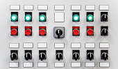 Control panel of industrial equipment with name plates, switches, red buttons and glowing green buttons