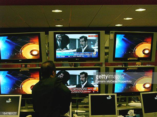 A control room at the headquarters of the Al Jazeera TV network in Doha Qatar 19th October 2005 The TV monitors are showing images from the trial of...