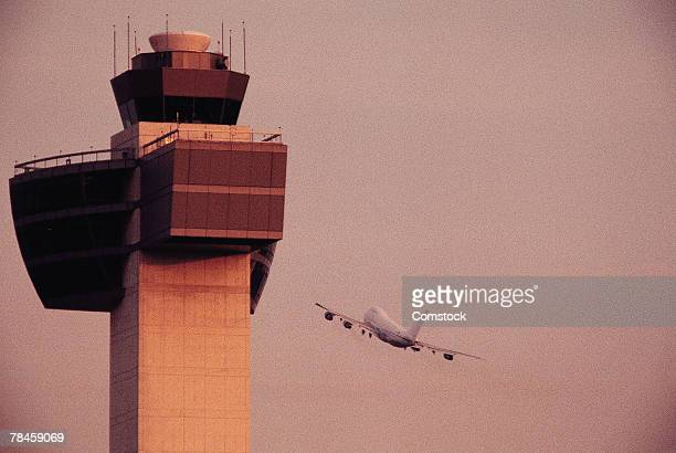 Control tower and airplane