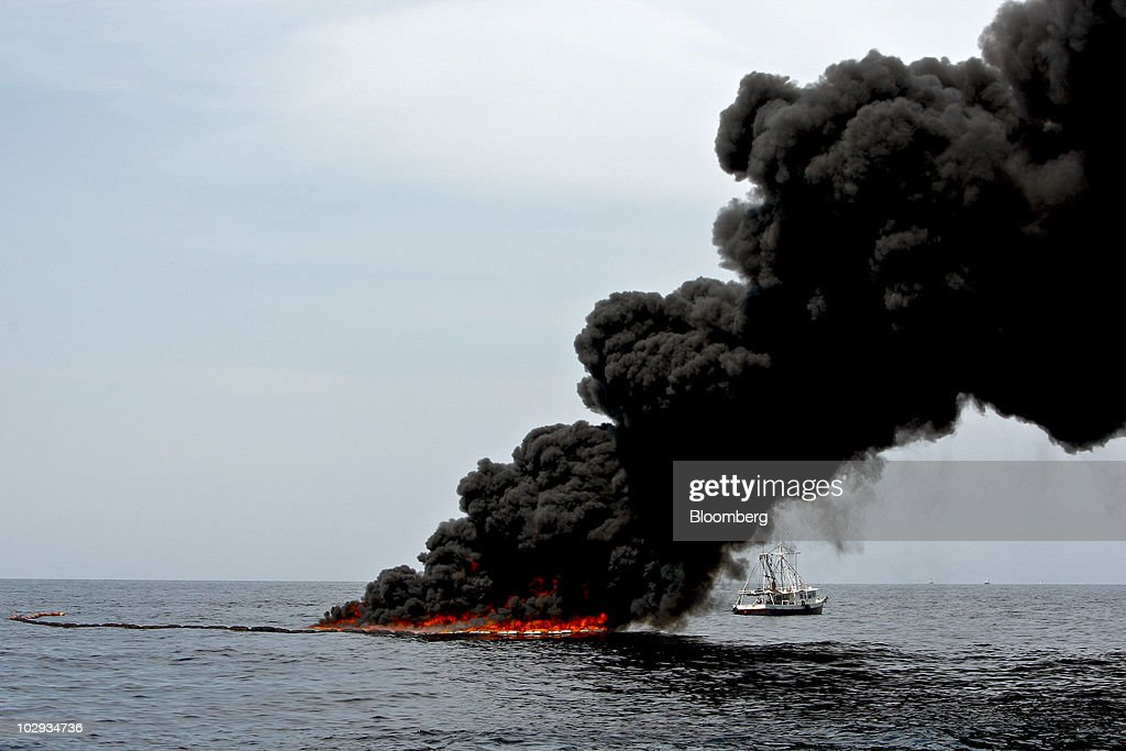 A controlled burn of oil is conducted near the source of the BP Plc Deepwater Horizon oil spill in the Gulf of Mexico off the coast of Louisiana, U.S., on Thursday, July 15, 2010. BP Plc said that a pressure test on its damaged Macondo well halted the flow of oil into the Gulf for the first time in three months. The oil spill, the biggest in U.S. history, had been spewing 35,000 to 60,000 barrels of oil a day since the drilling rig exploded on April 20. Photographer: Derick E. Hingle/Bloomberg via Getty Images