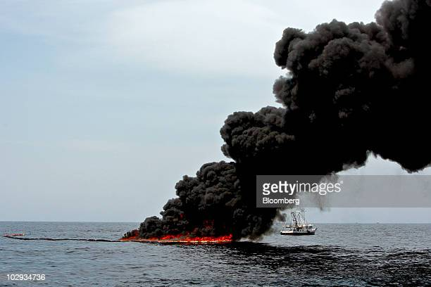 A controlled burn of oil is conducted near the source of the BP Plc Deepwater Horizon oil spill in the Gulf of Mexico off the coast of Louisiana US...