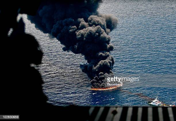 A controlled burn of oil on the surface of the water is seen from a US Coast Guard C144 aircraft near the site of the BP Plc Deepwater Horizon oil...