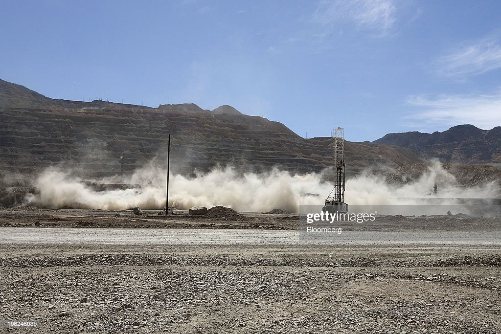 A controlled explosion takes place in Grupo Mexico SAB's La Caridad open pit copper mine in Sonora, Mexico, on Monday, May 6, 2013. Grupo Mexico SAB, Mexico's biggest mining company by market value, estimates it will produce 840,000 tons of copper in 2013. Photographer: Susana Gonzalez/Bloomberg via Getty Images