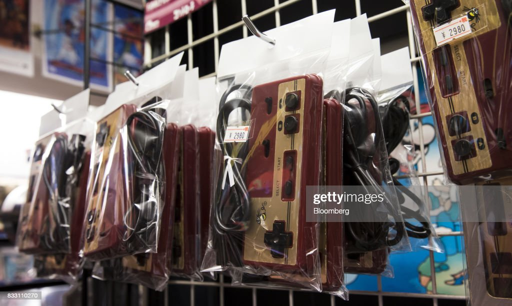 Controllers for the Nintendo Co. Nintendo Entertainment System (NES)/Famicom console are displayed for sale at the Super Potato video game store in the Akihabara district of Tokyo, Japan, on Tuesday, Aug. 8, 2017. Renewed interest in vintage Japanese videogamesis drawing buyers to the country'sonline markets and retro gaming shops. Photographer: Tomohiro Ohsumi/Bloomberg via Getty Images