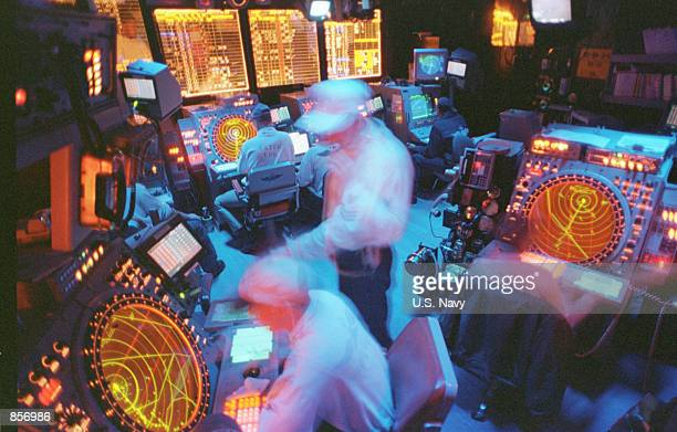 Controllers working in the Carrier Air Traffic Control Center 'CATCC' on board the USS Enterprise assist in guiding strike aircrafts in and out of...