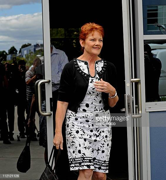 Controversial former Australian politician Pauline Hanson walks out to speak to the media in Sydney after narrowly failing in her bid to win a seat...