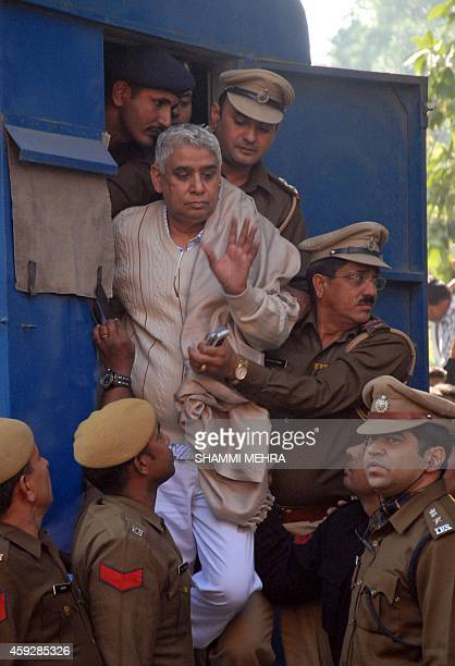Controversial Indian guru Rampal Maharaj is escorted by Haryana police out of the police vechile on his arrival at the Punjab and Haryana High Court...