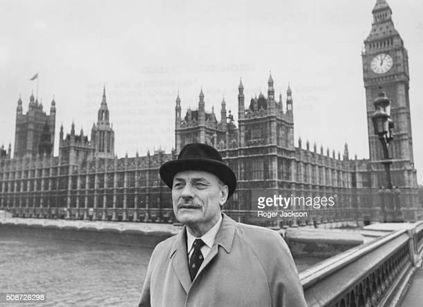 Controversial politician Enoch Powell pictured on Westminster Bridge in view of the Houses of Parliament as he prepares to return to the House of...