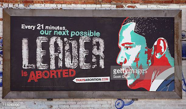 A controversial prolife billboard depicting President Barack Obama hangs on a wall outside of a car wash March 29 2011 in Chicago Illinois Thirty of...