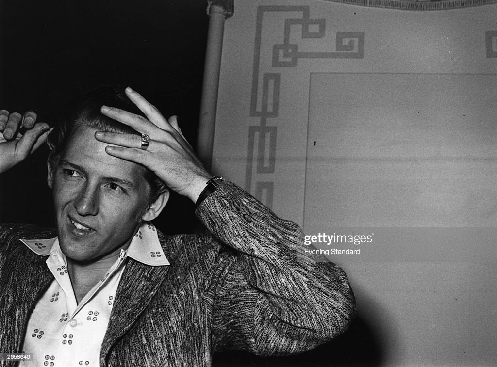 Controversial rocker Jerry Lee Lewis combing his hair in London.
