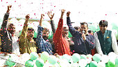 AAP convener and chief ministerial candidate Arvind Kejriwal along with party leader Kumar Vishwas Ashutosh Ashish Khetan Sanjay Singh raise hands in...