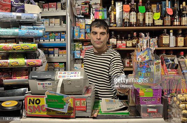 Convenience store owner handing over cigarettes.