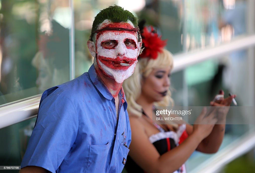 A convention attendee is made up as The Joker from the Batman series New 52, The Death of the Family, during Comic-Con International 2016 in San Diego, California, July 22, 2016. / AFP / Bill Wechter