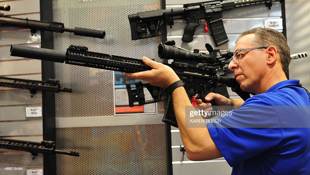 A convention goer aims a well appointed semiautomatic weapon at the 2015 NRA Annual Convention in Nashville Tennessee on April 10 2015 The annual NRA...
