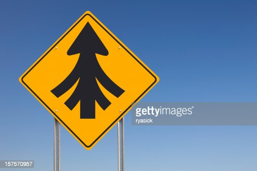 Convergence or Multiple Merges Ahead Traffic Sign Post Over Sky