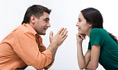 Happy couple having conversation face to face and looking at each other    Note to inspector: the image is pre-Sept 1 2009