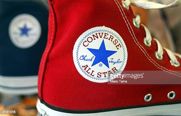 Converse 'Chuck Taylor' sneaker sits on a shelf July 10 2003 in New York City Nike announced it will buy rival sports shoemaker Converse for $305...