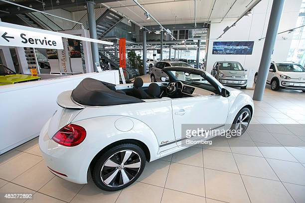 A convertable Volkswagen Beetle automobile sits on display inside the Volkswagen AG showroom in Berlin Germany on Thursday Aug 6 2015 In Europe the...