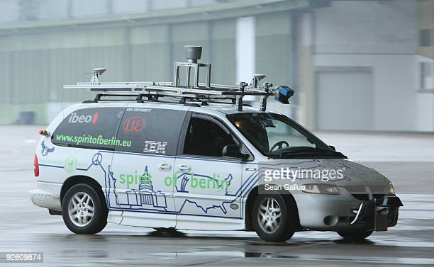 A converted Dodge minivan is steered remotely with an iPhone by a student of the department for aritificial intelligence at the Freie Universitaet...