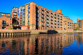 Converted warehouse flats by the river Aire in Leeds