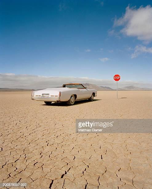 Convertible car at stop sign, rear view