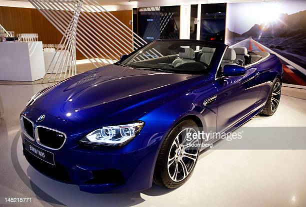 M6 convertible produced by Bayerische Motoren Werke AG is seen on display inside the company's new brand store in Paris France on Wednesday May 23...