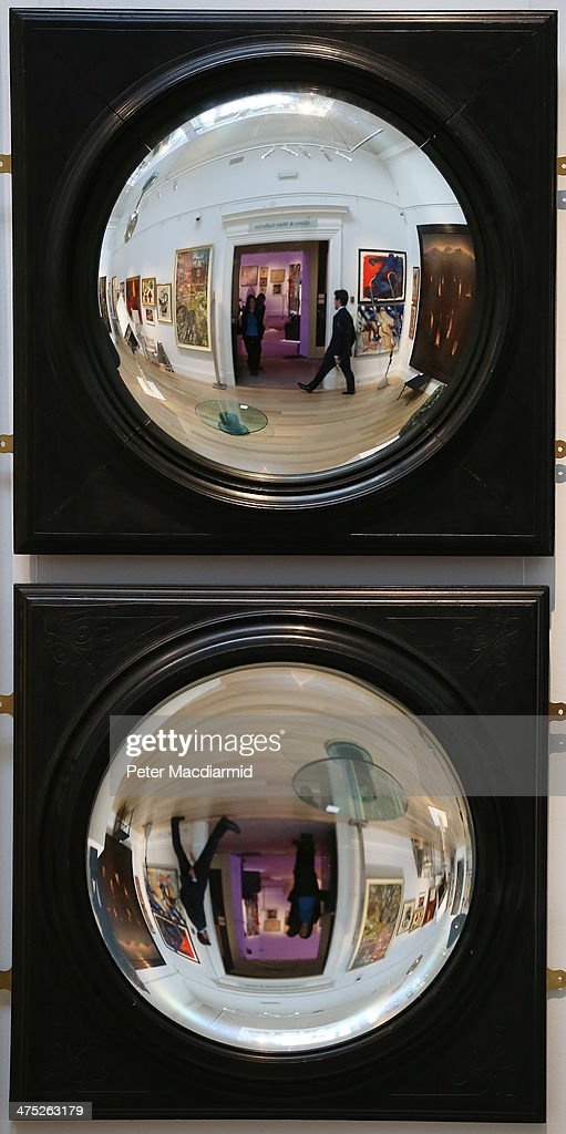 Convex and concave mirrors are shown at Sotheby's on February 27 2014 in London England Sotheby's '1000 Ways of Seeing' highlights the private...