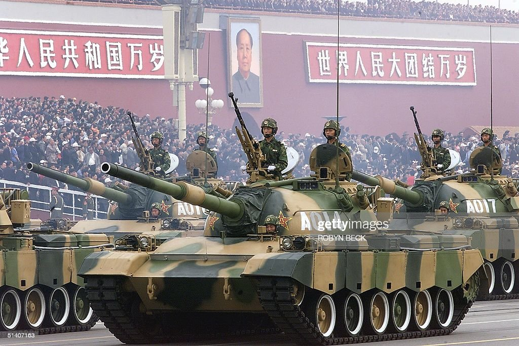A convey of People's Liberation Army tanks pass in front of Beijing's Tiananmen Square 01 October 1999 during a national day parade celebrating the...