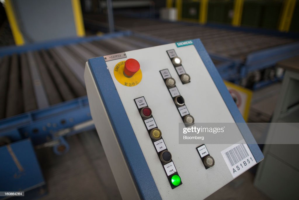 A conveyor belt control panel is seen in the Cathay Pacific Cargo Terminal in Hong Kong, China, on Monday, Feb. 4, 2013. Cathay Pacific Airways Ltd. aims to replicate its business-class strategy in a cargo trade upgrade. Photographer: Jerome Favre/Bloomberg via Getty Images