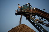 A conveyor belt deposits processed rock ore onto a dump at the Kibali gold mine operated by Randgold Resources Ltd in Kibali Democratic Republic of...