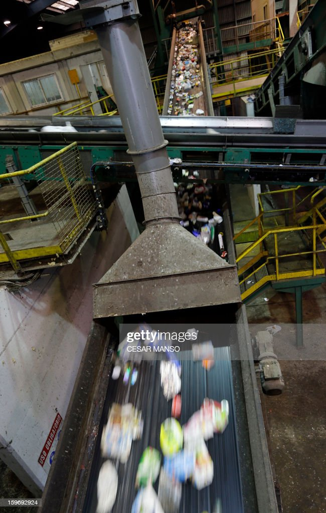 A conveyor belt with garbage for recycling is seen at a waste treatment plant in Burgos on January 18, 2013.