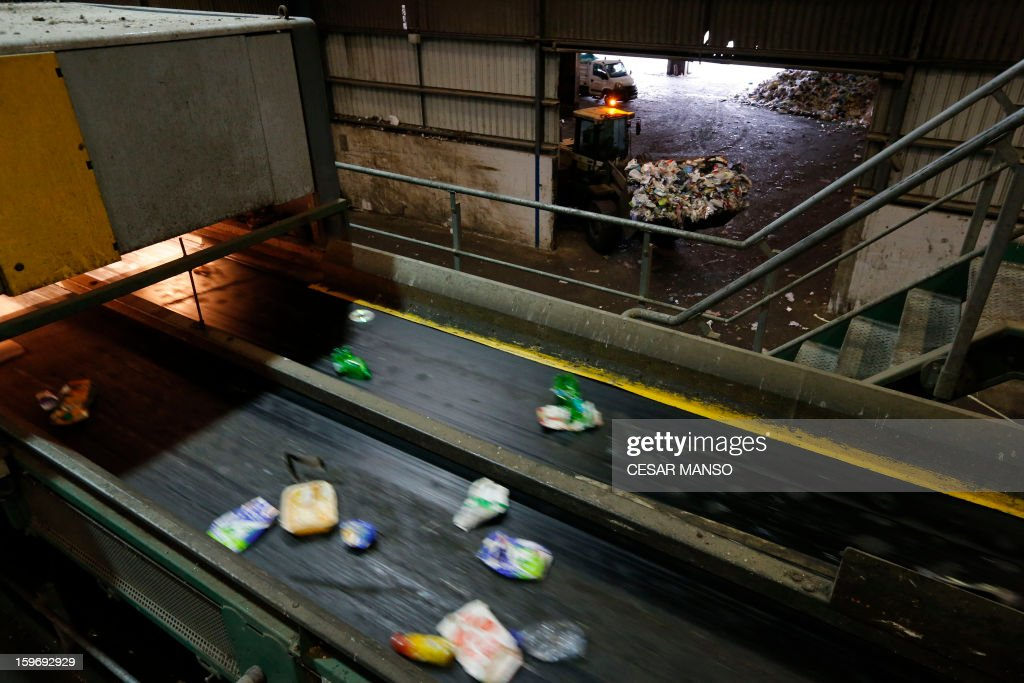 Conveyor belts carry away garbage for recycling at a waste treatment plant in Burgos on January 18, 2013.
