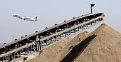 Conveyor belts pile recycled concrete into large mountains of materials at the west end of LAX that will used build a new runway A hurculean effort...