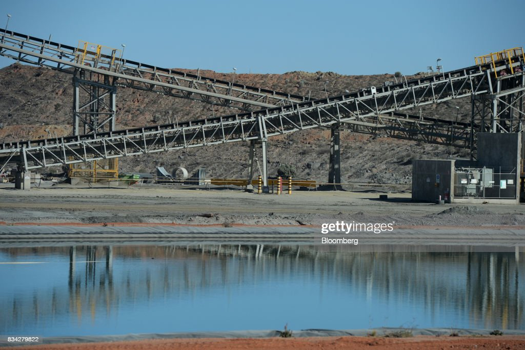 Conveyor belts stand at the processing plant of Evolution Mining Ltd.'s gold operations in Mungari, Australia, on Tuesday, Aug. 8, 2017. Evolution Mining is Australias second-largest gold producer. Photographer: Carla Gottgens/Bloomberg via Getty Images