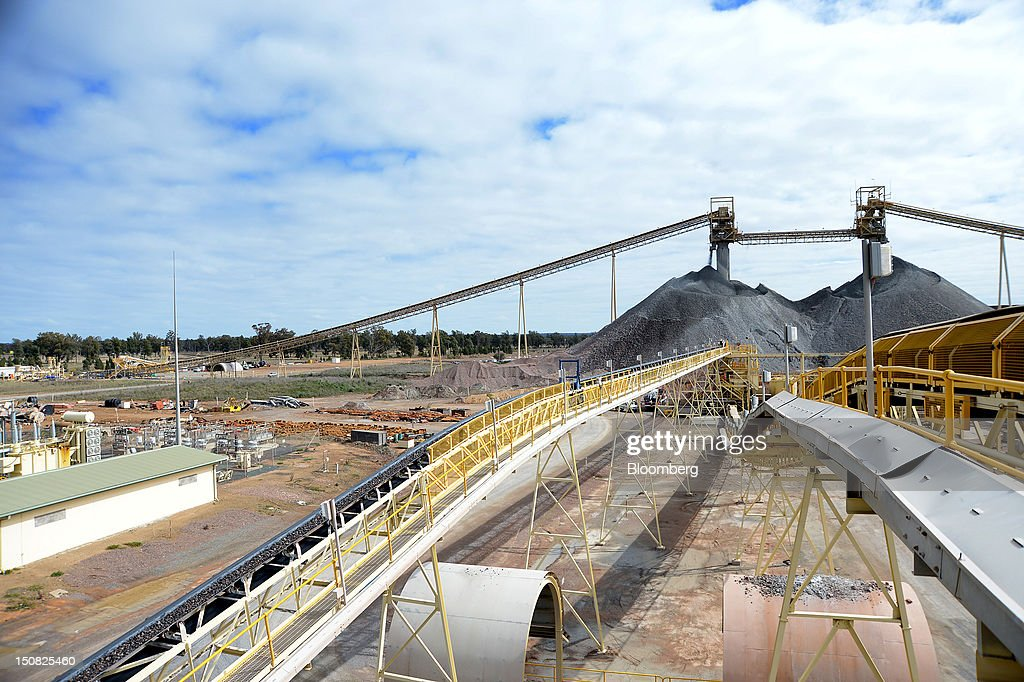 Conveyor belts transport copper ore from a stockpile to the grinding facility at the processing plant of Rio Tinto Group's Northparkes copper and gold underground block cave mine in Parkes, New South Wales, Australia, on Friday, Aug. 24, 2012. Northparkes last year produced 50,000 tons of copper. Rio owns 80 percent of the operation and Sumitomo Corp., the remainder. Photographer: Carla Gottgens/Bloomberg via Getty Images