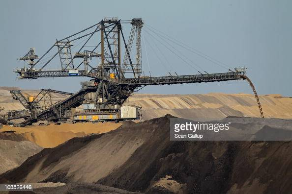 A conveyor bridge deposits soil removed from one end of the Welzow openpit lignite coal mine to allow excavators to reach the coal underneath on...