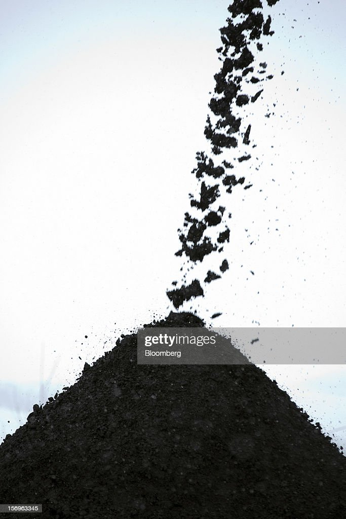 A conveyor drops coal into storage piles at the Sibirginsky open pit coal mine, owned by OAO Mechel and operated by Southern Kuzbass Coal Co., near Myski, in Kemerovo region of Siberia, Russia, on Friday, Nov. 23, 2012. OAO Mechel is Russia's biggest maker of steelmaking coal. Photographer: Andrey Rudakov/Bloomberg via Getty Images