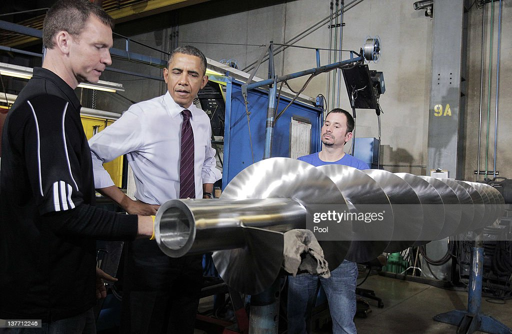 Conveyor Engineering & Manufacturing president Graig Cone (left) explains a screw conveyor to President <a gi-track='captionPersonalityLinkClicked' href=/galleries/search?phrase=Barack+Obama&family=editorial&specificpeople=203260 ng-click='$event.stopPropagation()'>Barack Obama</a> as employee Keith Blovich (right) stands by during a tour at Conveyor Engineering & Manufacturing January 25, 2012 in Cedar Rapids, Iowa. Obama, who is on a three-day tour, spoke about manufacturing and the economy during the speech.
