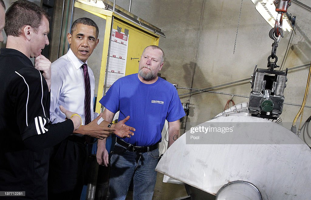 Conveyor Engineering & Manufacturing president Graig Cone (left) talks to President <a gi-track='captionPersonalityLinkClicked' href=/galleries/search?phrase=Barack+Obama&family=editorial&specificpeople=203260 ng-click='$event.stopPropagation()'>Barack Obama</a> as employee Dale Muldoon (right) stands by during a tour at Conveyor Engineering & Manufacturing January 25, 2012 in Cedar Rapids, Iowa. Obama, who is on a three-day tour, spoke about manufacturing and the economy during the speech.