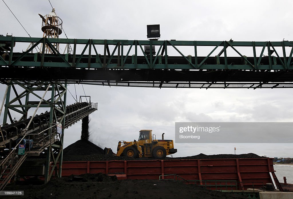 A conveyor loads coal onto a barge at the loading dock of the PT Exploitasi Energi Indonesia operations in Asam-Asam, South Kalimantan, Indonesia, on Monday Oct. 29, 2012. Indonesia, the world's largest exporter of coal for electricity generation, will reduce the amount of the fuel that producers must sell to buyers inside the country for next year by 9.4 percent. Photographer: Dadang Tri/Bloomberg via Getty Images