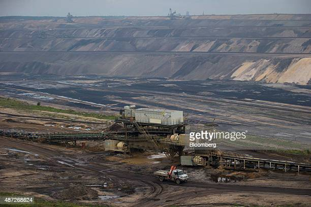 Conveyor machinery stands on the surface terrain of an open pit lignite mine also known as brown coal operated by RWE AG in Hambach Germany on Monday...